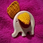 Wooden elephant with knitted ears